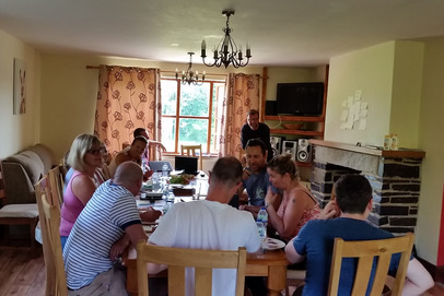 Group sat at table Sherrill Farm Devon